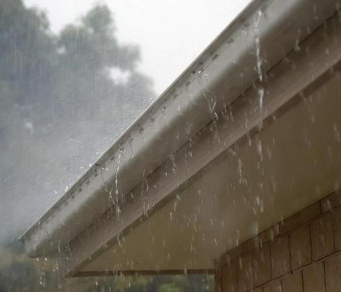 Water pouring off gutter
